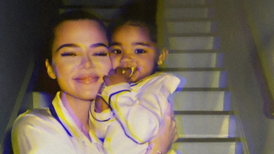 Khloe Kardashian Snuggles Daughter True Thompson in Matching White Silk Pajamas