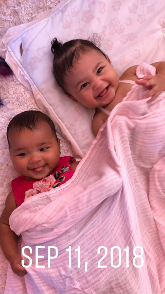 Stormi Webster and True Thompson Lay Under Pink Blanket and Giggle