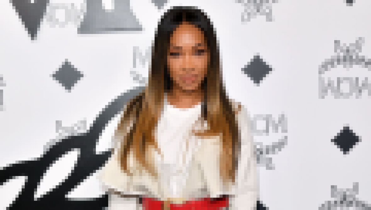 Malika Haqq Smiles in White Dress Red Belt and Tan Thigh High Boots