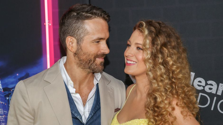 Ryan Reynolds Wears Tan Suit and Denim Vest and Stares at Wife Blake Lively in Sparkly Yellow Gown