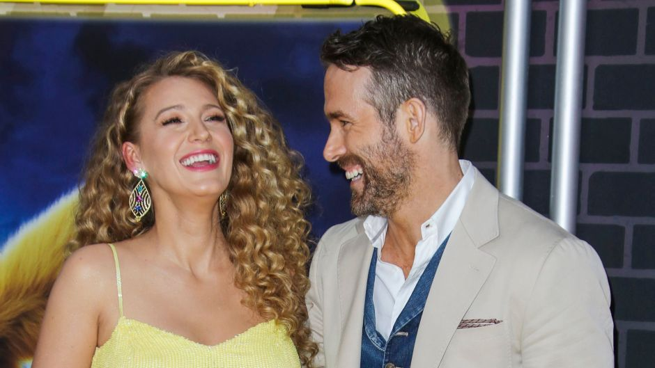 Blake Lively Wears Yellow Dress and HOlds Baby Bump While Laughing With Husband Ryan Reynolds in Tan Suit and Denim vest