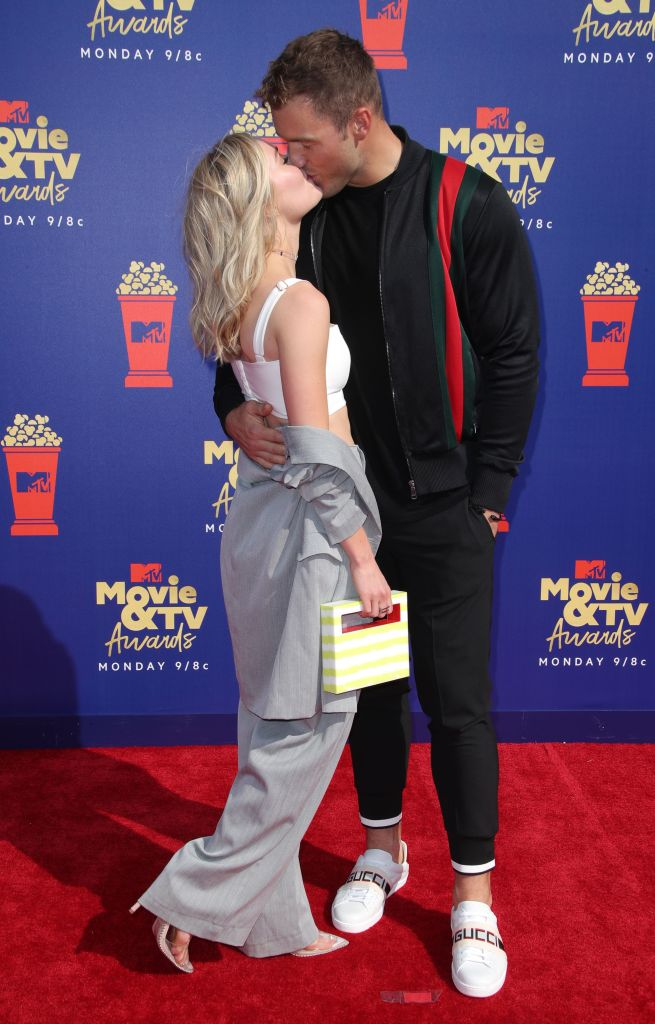 Colton Underwood Kisses Cassie Randolph Wearing a White Crop Top and Grey Pants