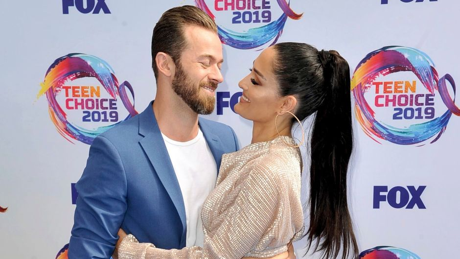 Nikki Bella Wears Sparkly Jumpsuit and Long Ponytail and Hugs Fiance Artem Chigvintsev in Blue Suit and Tshirt at Teen Choice Awards