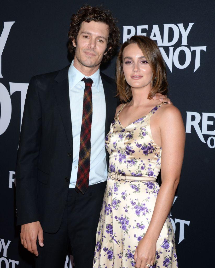 Leighton Meester Smiles in Silk Flower Dress With Husband Adam Brody in Suit