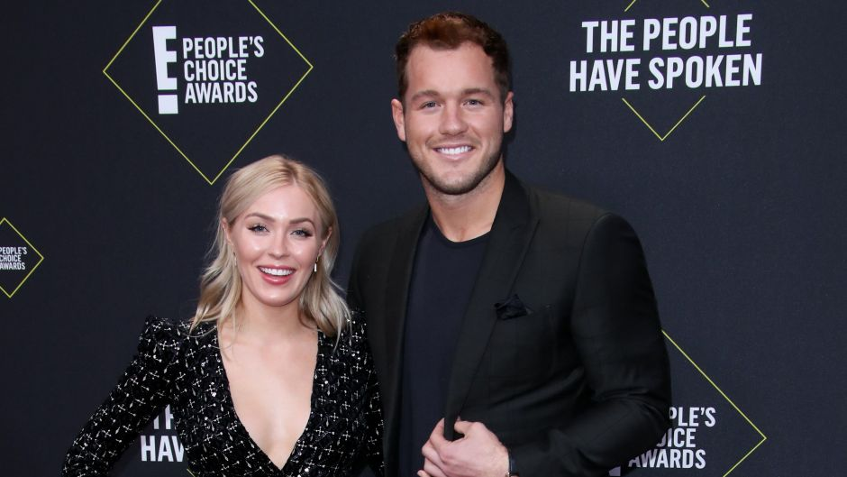 Bachelor Colton Underwood Smiles in Black Suit With Arm Around Girlfriend Cassie Randolph in Black Wrap Dress