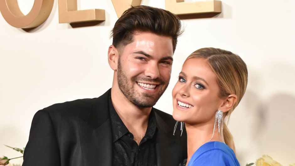 Hannah Godwin Smiles in Blue Silk Dress with Fiance Dylan Barbour in Black Suit