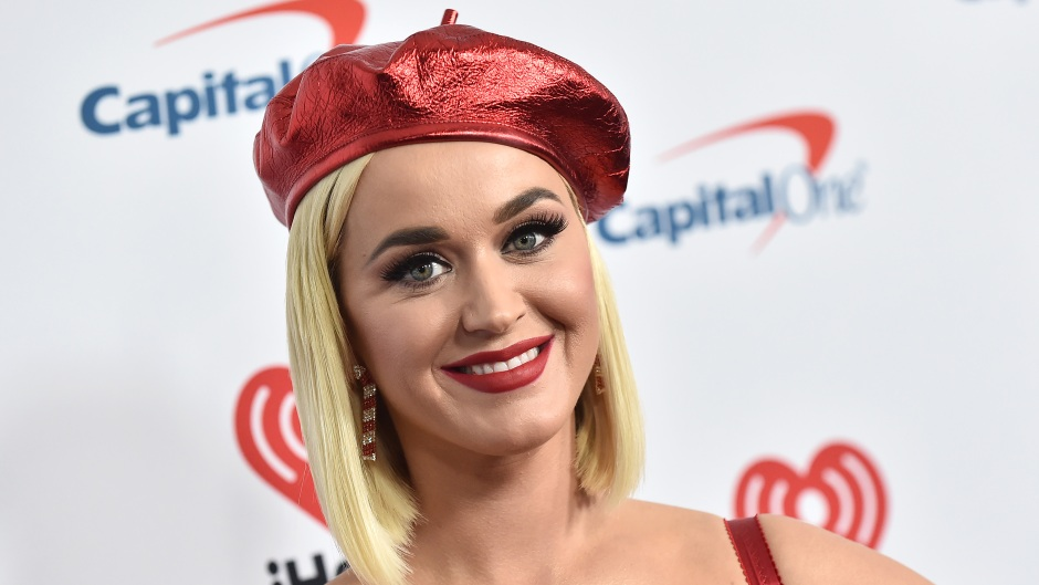 Katy Perry Smiles in Red Beret and Lipstick