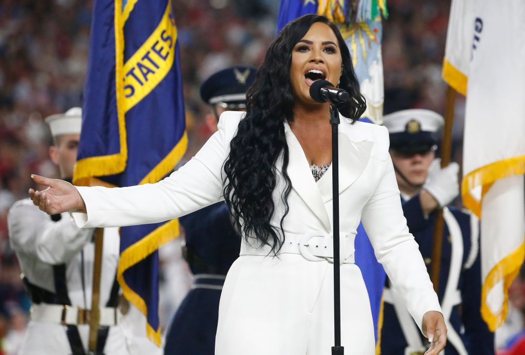 Demi Lovato Sings the National Anthem at the Super Bowl in a White Suit
