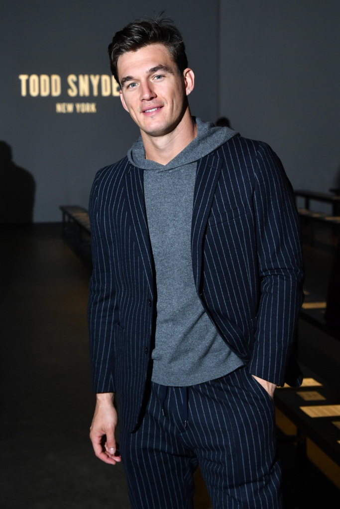 Bachelorette Contestant Tyler Cameron Wears Grey Hoodie and Pinstriped Blazer