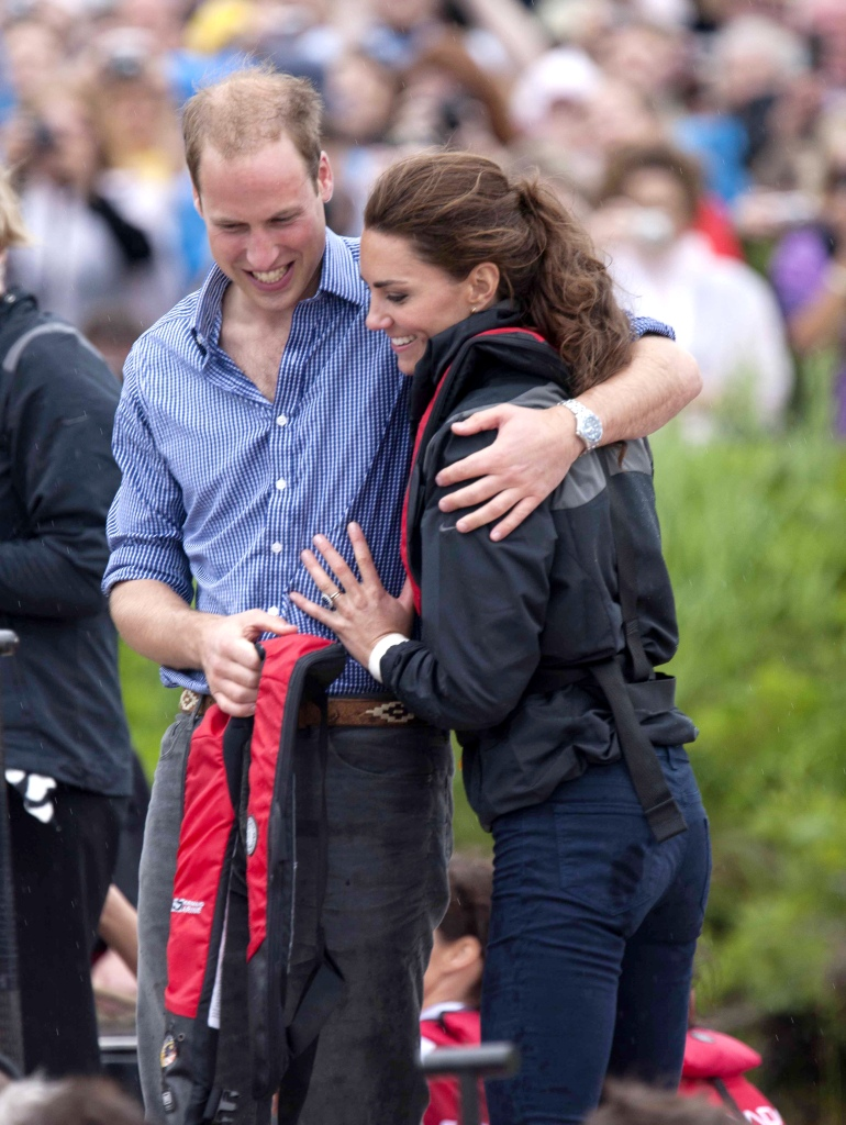 Prince William Hugs Kate Middleton While Wet as They Both Laugh