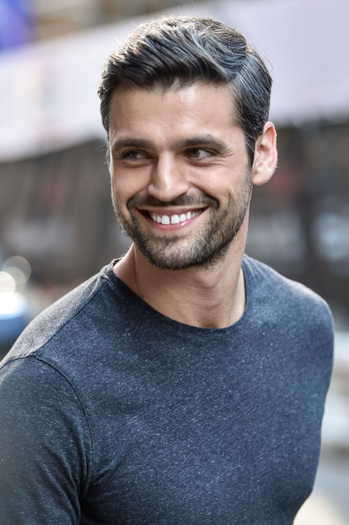Bachelorette Contestant Peter Kraus Smiles in Grey Shirt