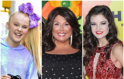JoJo Siwa Wears Blue and Purple Holographic Hoodie and Purple Bow Abby Lee Miller Smiles in Brown Wig and Sparkly Black Top Brooke Hyland Wears Red Sequined Dress and Red Lipstick