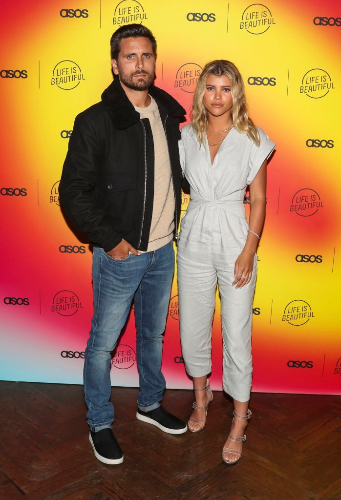 Scott Disick Wears Jeans and Jacket With Sofia Richie in Grey Jumpsuit