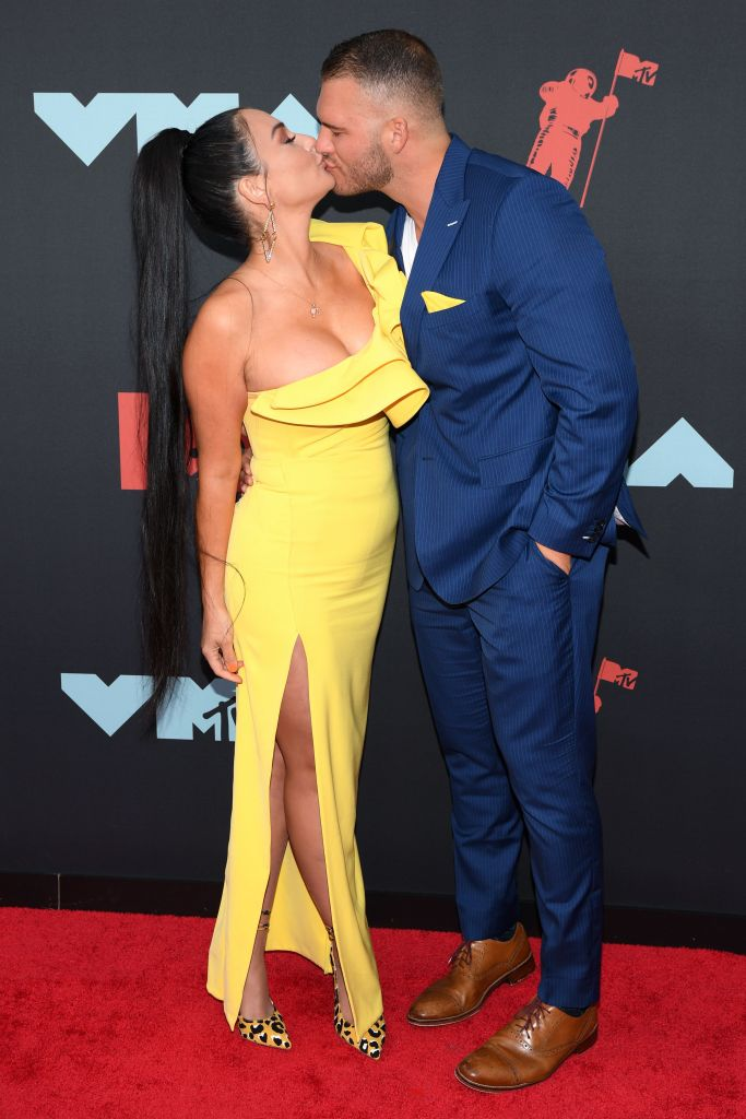 Jenni Farley Wears Yellow Gown and Kisses Boyfriend Zack Clayton Carpinello in Blue Suit With Yellow Accents