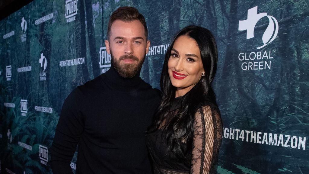 Nikki Bella Smiles in Black Dress and Red Lipstick With Fiance Artem Chigvintsev in Black Turtleneck