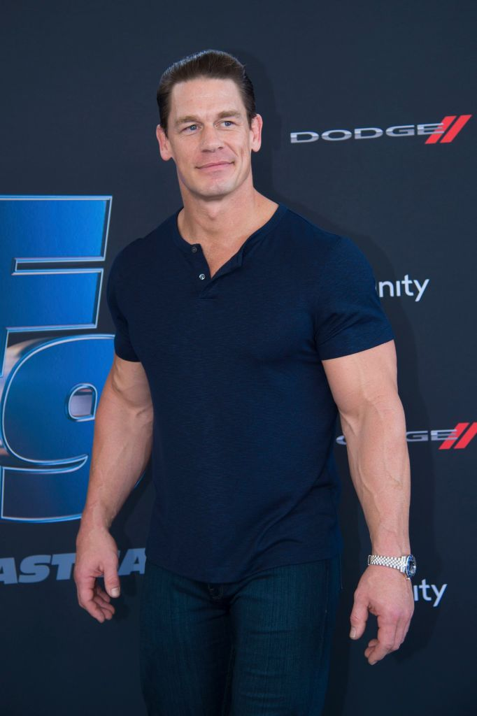 John Cena Smiles in Blue Shirt and Jeans