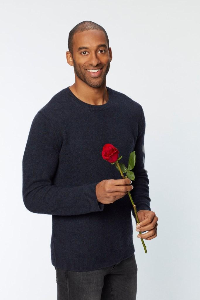 Bachelor Matt James Wears Sweater and Holds Rose