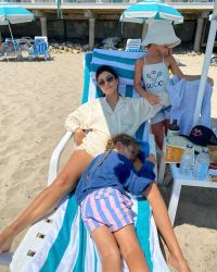 kourntey kardashian cuddling with kids on beach