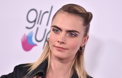 Cara Delevingne Wears Hair Half Up and Denim Jumpsuit