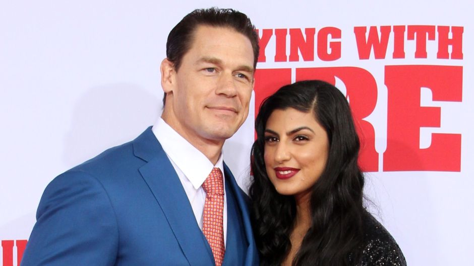 John Cena and Shay Shariatzadeh Cuddle Up on Playing With Fire Red Carpet