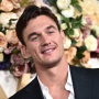 Bachelorette Contestant Tyler Cameron Smilews in Suit