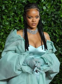 Rihanna Wears Turquoise Silk Dress and Sheer Cover With Braids