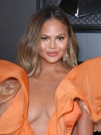 Chrissy Teigen Wears Orange Gown