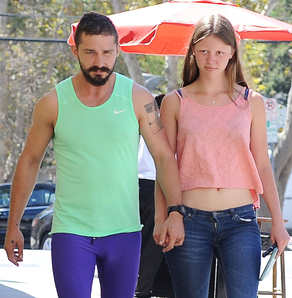 Shia LaBeouf and Mia Goth HOld Hands and Walk
