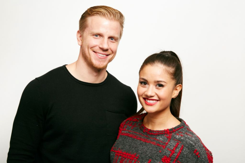 Bachelor Sean Lowe Smiles in Black Shirt With Wife Catherine Giudici in Grey and Red Sweater and Ponytail