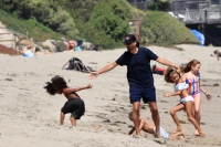 Scott Disick on the beach with Saint West