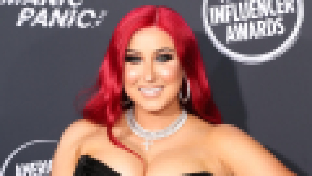 Beauty YouTube Vlogger Jaclyn Hill With Red Hair and Black Dress at American Influencer Awards