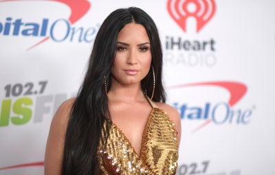 Demi Lovato Looks Serious in Gold Halter Dress and Long Straightened Hair