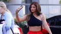 Kylie Jenner Shows Abs in Red Pants and Black Crop Top feature