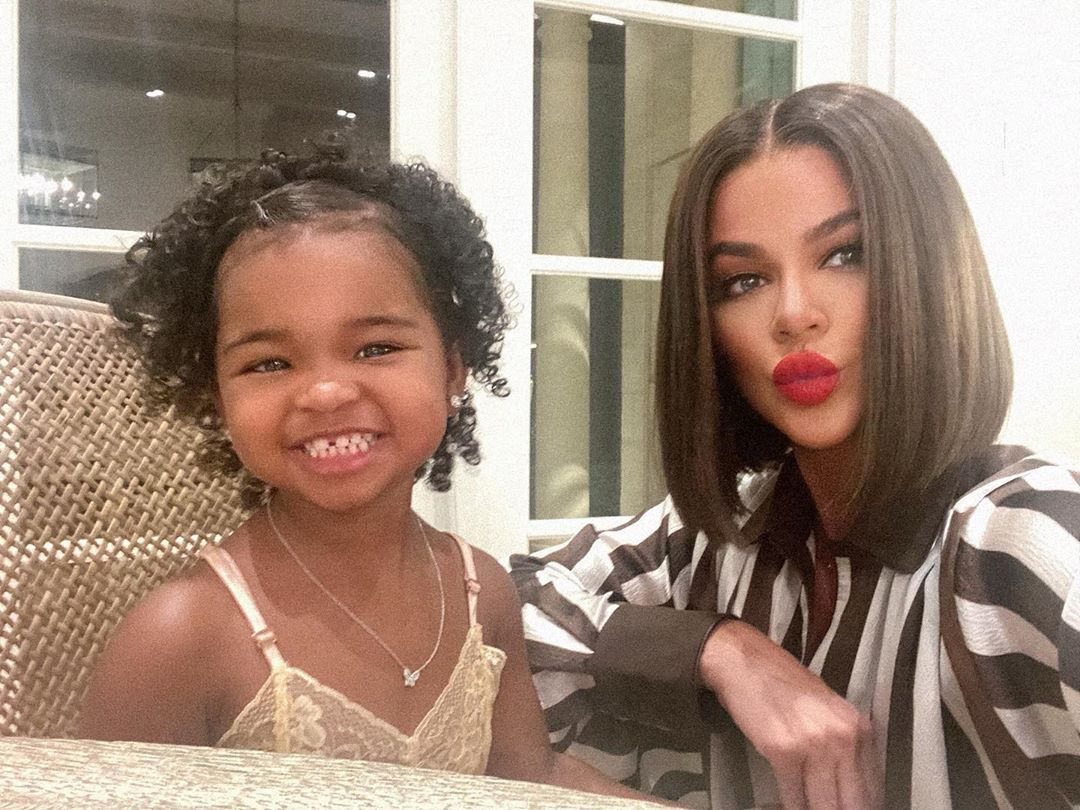 Khloe Kardashian in brown wig and Daughter True Smile Together