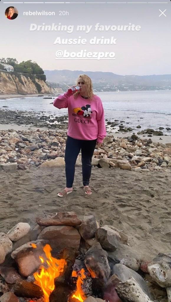 rebel-wilson-looks-fit-at-beach-bonfire