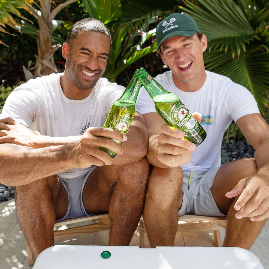 Matt James and Tyler Cameron cheersing with Heineken