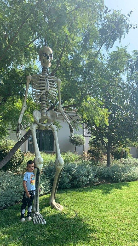 Kourtney Kardashian Decorates Her Backyard With a Giant-Sized Skeleton for Halloween