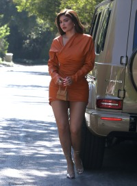 Kylie Jenner Stuns in an Orange Mini Dress, Strappy Sandals and Gold Jewelry: See Photos!