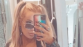 Tana Mongeau Rocks a Sexy All-Black Outfit With '90s-Inspired Hair and 'Bible' Earrings