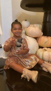 khloe-kardashian-true-thompson-plays-with-pumpkins-ig