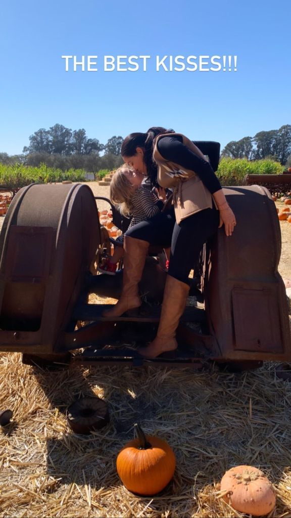 Nikki and Brie Bella a the pumpkin patch with birdie