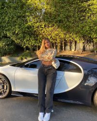 Big Flex! Kylie Jenner Flaunts Her Killer Curves While Posing With Her Bentley