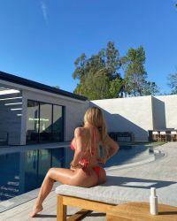 California Girl! Kylie Jenner Sunbathes in Her Backyard in a Tiny Red Bikini