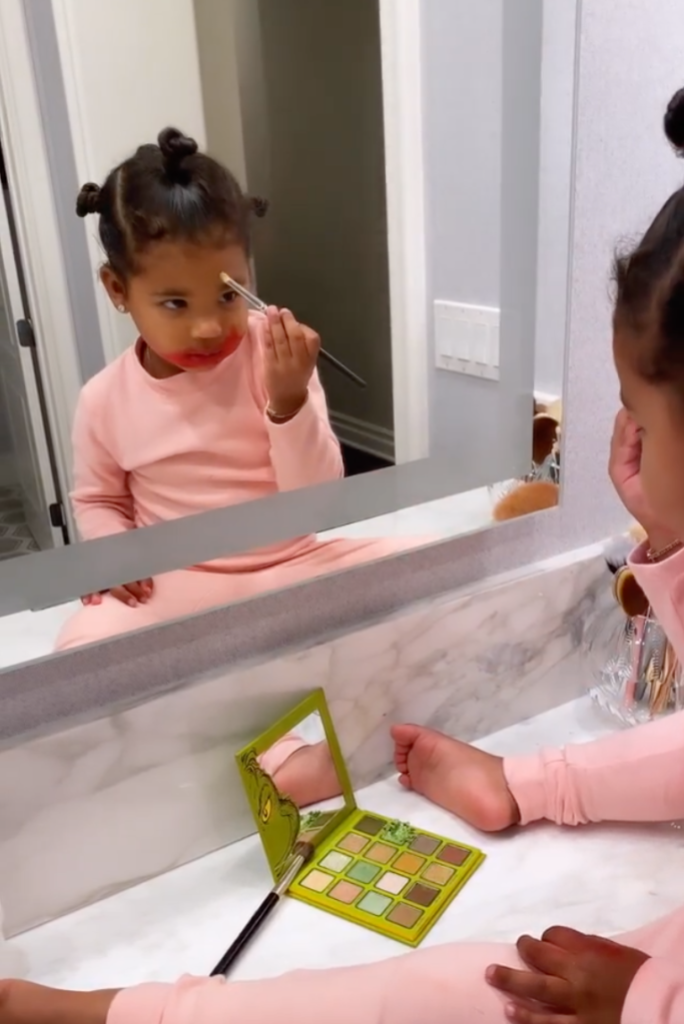 True Thompson Puts on Kylie Jenner's Grinch Makeup Collection