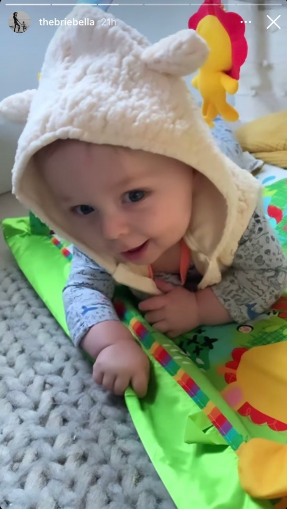 brie-bella-encourages-son-buddy-to-roll-over-during-tummy-time-ig