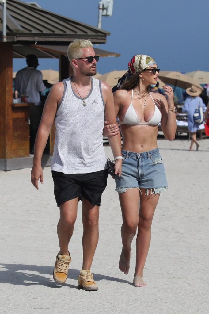 Amelia Hamlin shows off her curves in a white bikini as she hits the beach with boyfriend Scott Disick on Valentine's Day in Miami