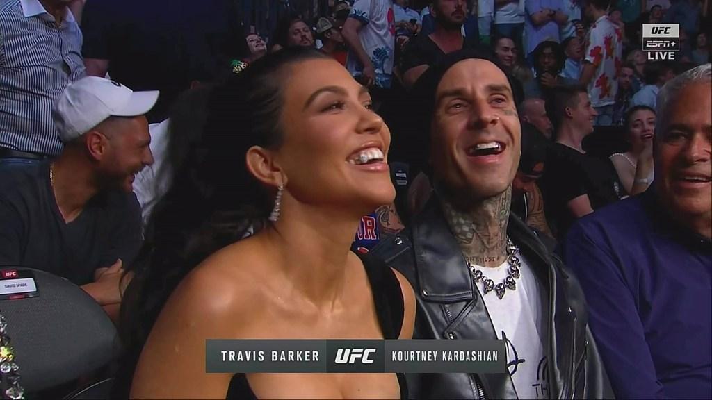 Kourtney Kardashian and Boyfriend Travis Barker Tongue-Kiss for Cameras During UFC Date Night in Vegas
